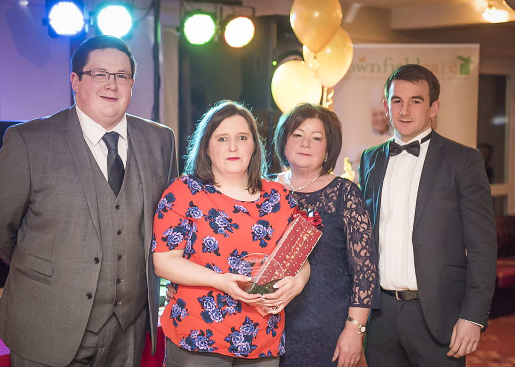 Employee of the Year, Michelle Palmer receiving her award from Maria, Michael & John Timmins